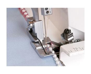 Лапка для оверлока Janome для вшивания бисера фото